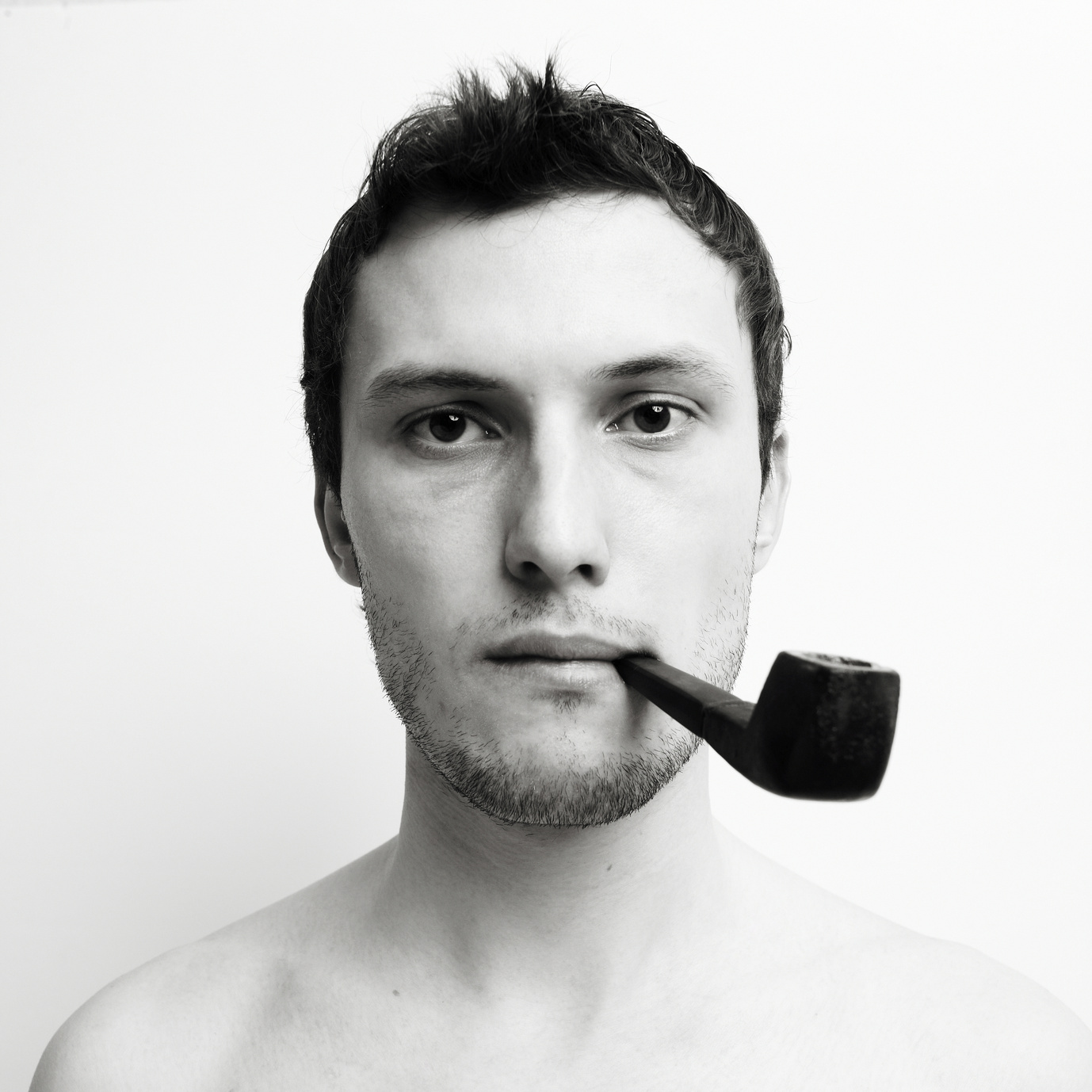 Young attractive  man with tube